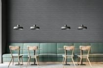 Dark gray wall bar interior, green sofas